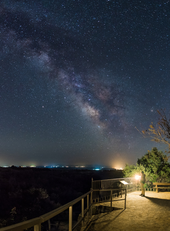 A person observes the Milky way arc from one lookout of the mountains of Gredos,Spain