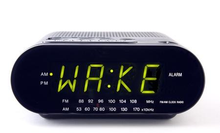 A Clock radio with the word WAKE