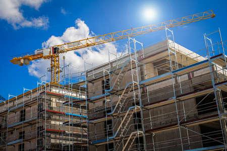 Photo pour Crane on a Construction Site under Blue Sky - image libre de droit