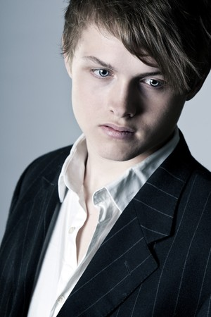Shot of a Handsome Teenage Boy in Suit and Shirt