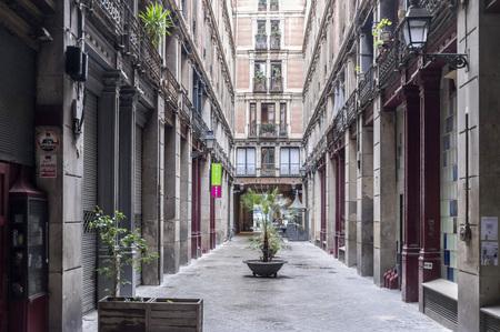 BARCELONA,SPAIN-NOVEMBER 2,2015: Ancient street facade house, passage, Pasaje del Credit, gothic quarter of Barcelona.