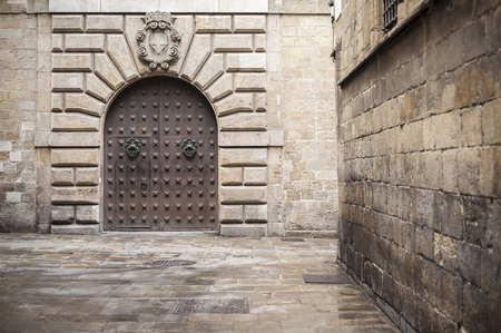 BARCELONA,SPAIN-AUGUST 31,2015: Ancient door in cathedral area, gothic quarter, Barcelona.