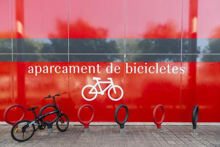 BARCELONA,SPAIN-MAY 16,2017:Bicycle parking, aparcament de bicicletes,catalan sign, Barcelona.