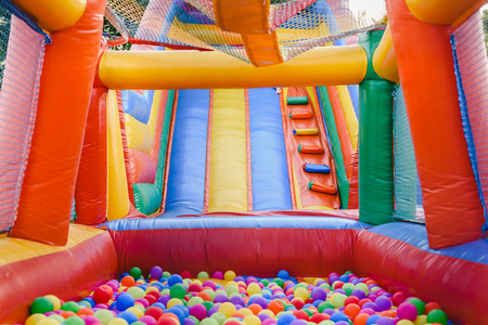 Photo pour Inflatable castle full of colored balls for children to jump - image libre de droit