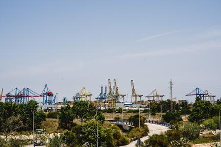 Cranes of longshoremen in the seaport of Valencia in the Mediterranean