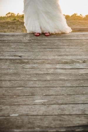 Foto de Detail of a white and elegant wedding dress. - Imagen libre de derechos