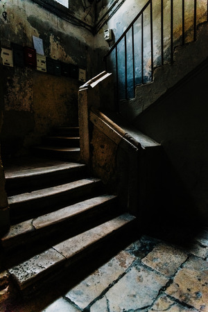 Photo pour Old stone stairs in the dark atrium of a disused building in the old part of Bari, Italy. - image libre de droit