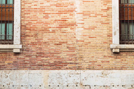 Photo pour Brick wall between two old windows, background with copy space to place text. - image libre de droit