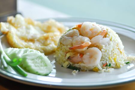 Photo for stir-fried rice with shrimp and fried egg and vegetable - Royalty Free Image