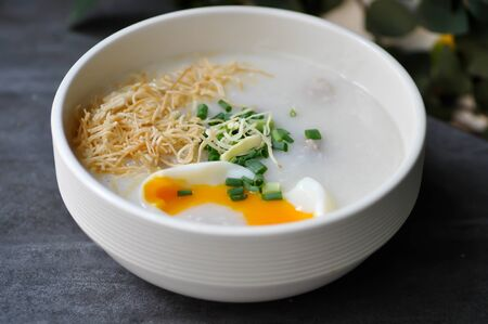 rice gruel, rice porridge or congee with egg