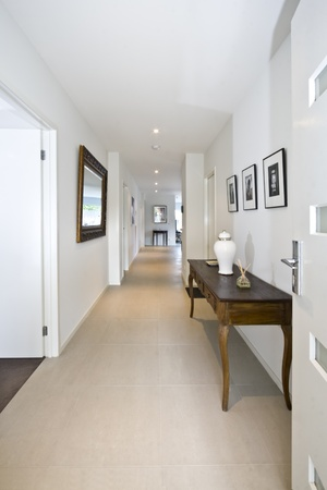 An open front door welcoming you into a stylish contemporary new home entrance area.