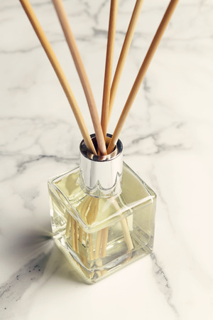 Aromatherapy reed diffuser air freshener on marble background