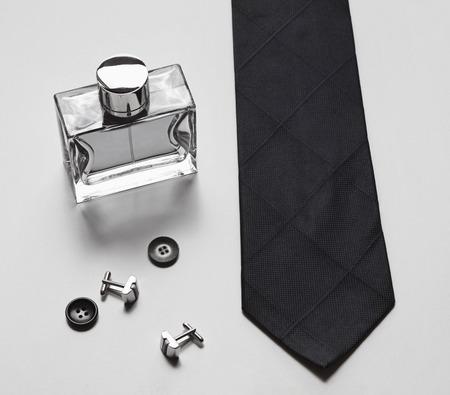 Photo pour Stylish mens business accessories tie cologne cufflinks - image libre de droit