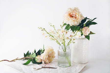 Photo for Florist preparation with a selection of vases scissors and string horizontal - Royalty Free Image