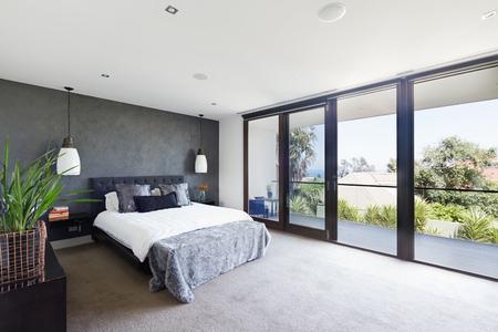 Photo pour Spacious interior of designer master bedroom in luxury contemporary Australian home - image libre de droit