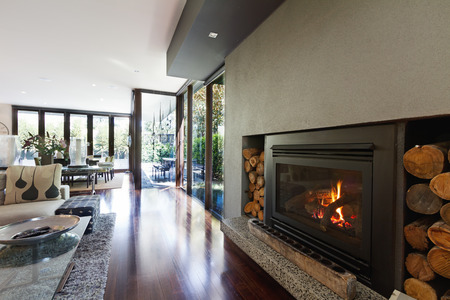 Foto de Cosy gas log fire in architect designed modern luxury open plan family home - Imagen libre de derechos