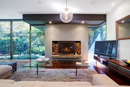Photo for Warm Australian living room with fireplace in contemporary luxury home - Royalty Free Image