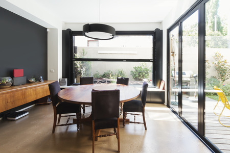 Family dining room extention with large glass windows and doors in Australian contemporary home