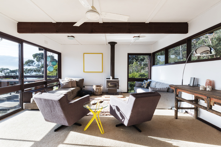 Funky Retro Beach House Living Room With 70s Style Recliner Chairs