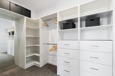 Photo pour Large walk in wardrobe cabinetry detail in new home - image libre de droit