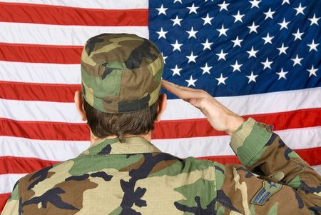 Foto per A vetern soldier salutes his flag on Memorial Day - Immagine Royalty Free