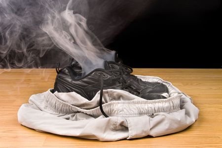 Smoking shoes and shorts insinuate that a person has vanashed right out of their clothing.