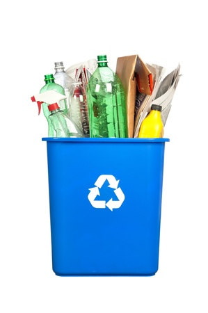 A recycling bin with plastic bottles, paper, cardboard and other plastic items isolated on white.