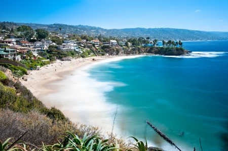 An image of a beautiful cove called Crescent Bay in Laguna Beach, California.  Shot with a slow shutter to capture the water motion on a bright sunny day.