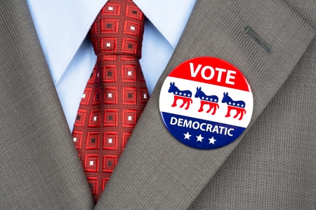 Close up of a democrat voting badge on the suit jacket lapel of an American voter.