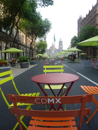 Tables and chairs for tourists near the Zocalo square in Mexico City