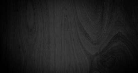 Photo pour Close-up corner of wood grain Beautiful natural black abstract background Blank for design and require a black wood grain backdrop - image libre de droit