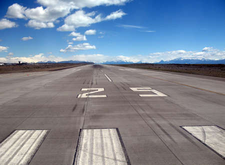 Runway 25 of an airport close to the mountains