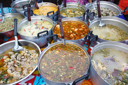Photo pour Stall of curry Thai spicy food in market - image libre de droit