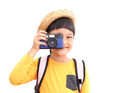 Photo pour Happy  traveler girl take a photo with retro compack camera. Isolated on white background - image libre de droit