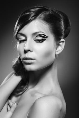 Photo pour A beautiful girl posing on dark background - image libre de droit