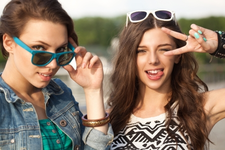 Portrait of two young woman having fun. Outdoors, lifestyle