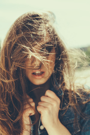 Close-up of hipster girl with windy hair