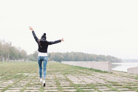 Beautiful young girl walking and having fun.