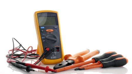 An impedance mutimeter complete with probe and  a electrical insulated plier and three insulated screwdriver completed with philips and flat types.