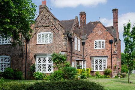 Port Sunlight, UK: June 6, 2018: A model village built to house the workers of the adjacent Lever Bros soap factory. Each house is individually architect designed in quintessential English styling.