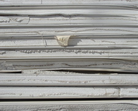 stacked industrial isolation foam on a demolition site