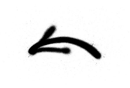 Graffiti spray arrow sign in black over white