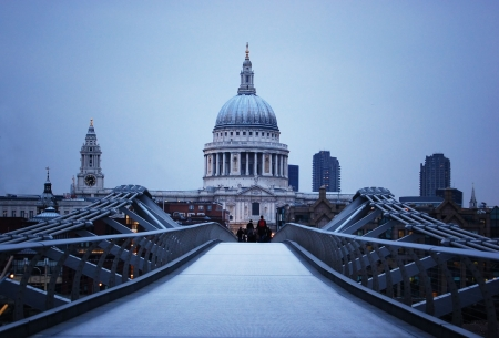 St Paul's Cathedral and Millennium Bridge in London at evening.