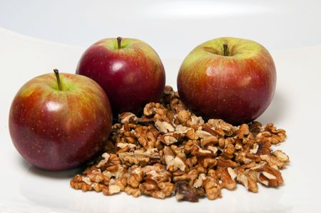 Picture of three apples and walnuts, horizontal shot.