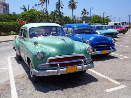 Detail of colorful group of vintage American cars.