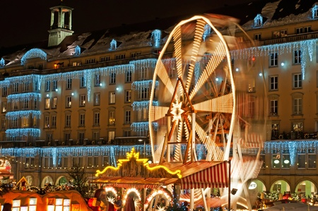 DRESDEN, GERMANY - 20 DECEMBER: An unidentified group of people enjoy Christmas market in Dresden on December 20, 2010 in Dresden, Germany. It is Germany's oldest Christmas Market with a very long history dating back to 1434.