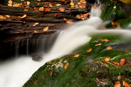 Detailed view of a beautiful waterfall during the autumn time.