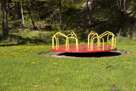 Photo for Empty Red and Yellow Merry Go Round In A Park - Royalty Free Image