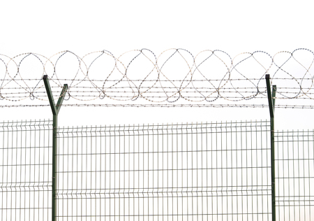 barbed wire and fence for security at airport or prison