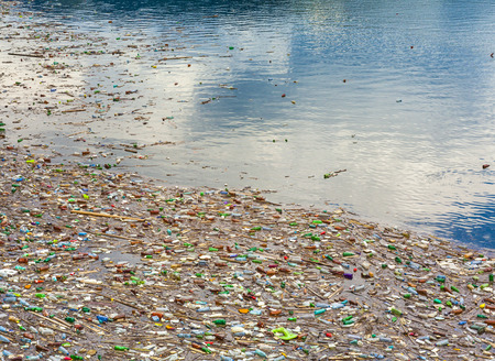 Photo pour lake pollution with plastic bags and toxic waste in the water - image libre de droit